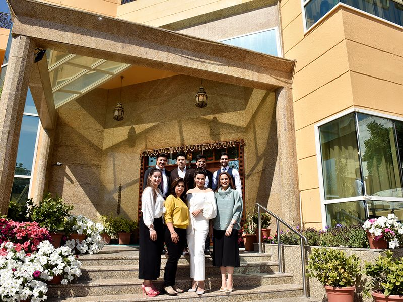 Sanjay and Vinay Jethwani with their family in front of their posh villa in Jafliya